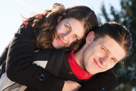 Happy young couple outdoors playing in snow  photo