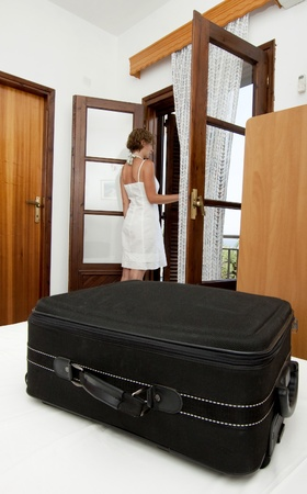 Woman arriving in simple pension bedroom Stock Photo - 8731851