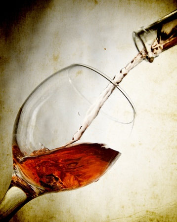 wine growing: Red vine in glass on vintage background  Stock Photo