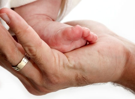 Baby leg in father's hand Stock Photo - 8905961