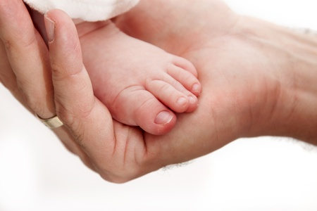 Baby leg in father's hand Stock Photo - 8905965