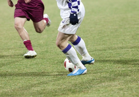 Soccer players running after the ball Stock Photo - 9070710