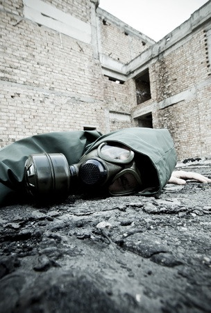 Man with gas mask fallen on the ground Stock Photo - 9420508
