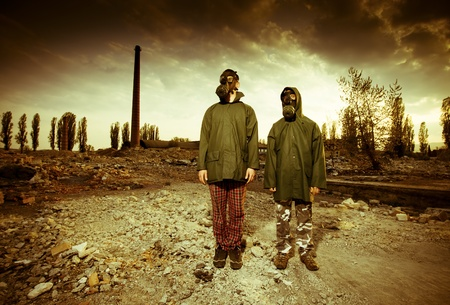Two man wearing gas masks after nuclear disaster Stock Photo - 9729980