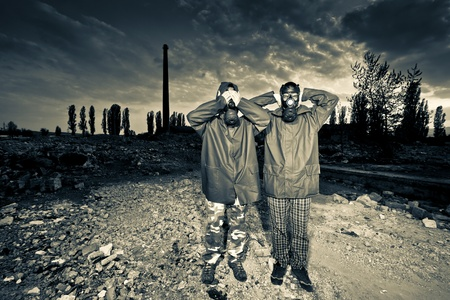 Two man wearing gas masks after nuclear disaster Stock Photo - 9729981