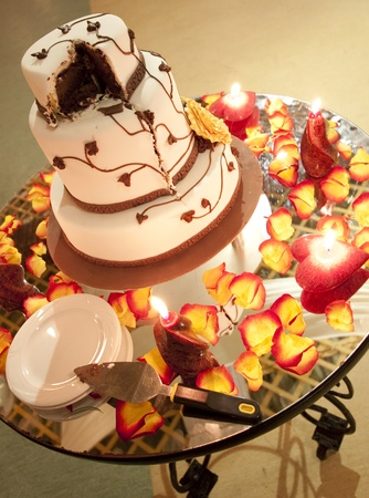 Wedding cake surrounded with candles and petals Stock Photo - 10846816