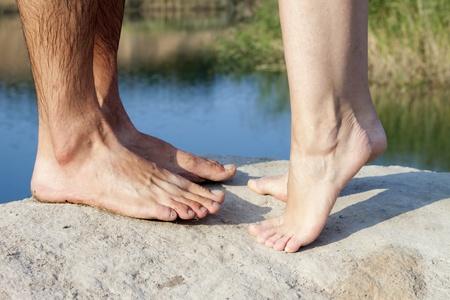 foot bridge: couple feet kissing near lake