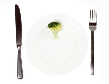 low fat diet: Small broccoli on plate Stock Photo