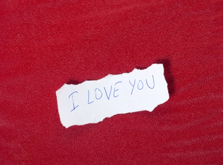 plied: Ripped paper on red background with message of love