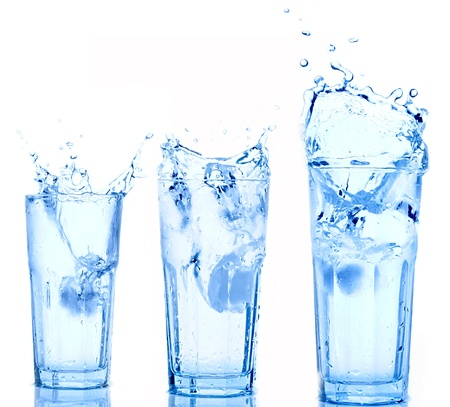 Water splash in glasses isolated on white photo