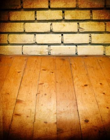 vintage brick wall and wood floor texture interior photo