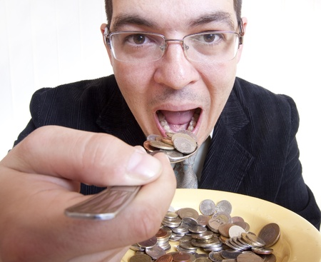 greed: Funny businessman eating money