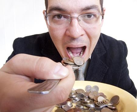 hoard: Funny businessman eating money