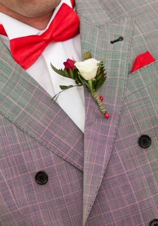 tie tuxedo: Groom with red bow tie  Stock Photo