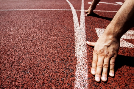 athletic symbol: Hands on starting line  Stock Photo