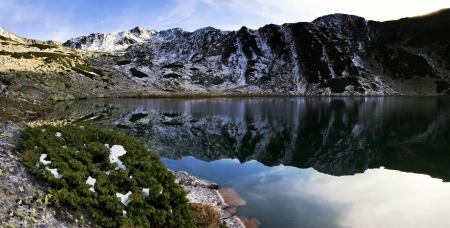 skydive: Alpine lake reflection - Retezat Mountains, Southern Carpathians, Romania  Stock Photo
