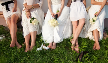 silver dress: Bride and bridesmaids legs