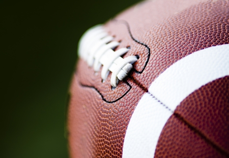 touchdown: Close up of an american football against a black background