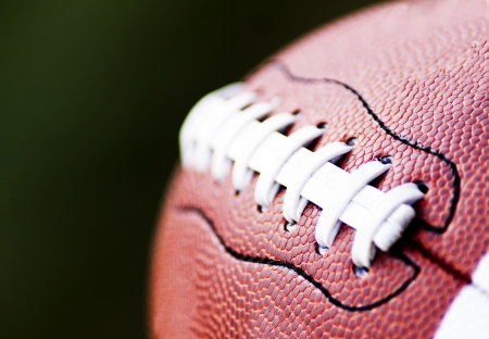 Close up of an american football against a black background  Stock Photo - 15752715