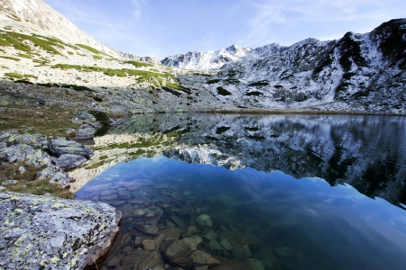 Alpine lake reflection - Retezat Mountains, Southern Carpathians, Romania  photo