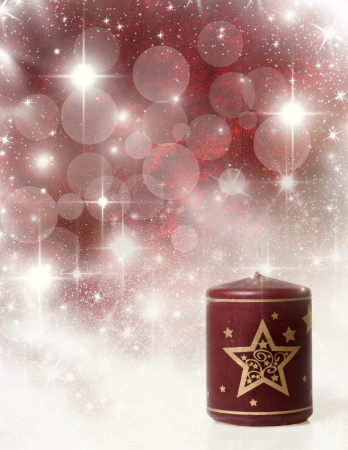 Vintage Christmas background with red candle photo
