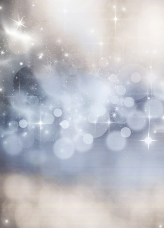 Light bokeh abstract Christmas background with white snowflakes photo