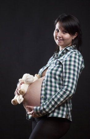 Beautiful pregnant woman on dark background  Stock Photo - 16968227