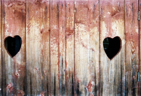 Vintage photo of two hearts in wood  photo