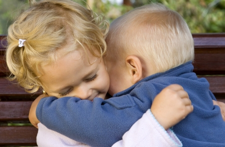 Happy adorable kids hugging each other photo