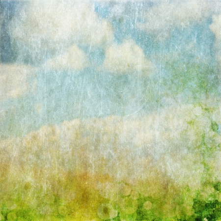 de focus: Vintage paper background - blue sky with clouds and green field