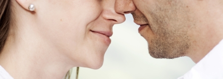 close up portrait of young caucasian couple just about to kiss photo
