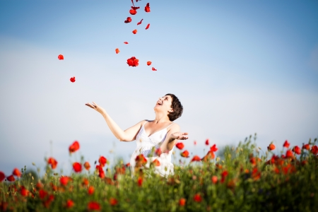poppy field: Young casual woman relaxing in poppy field Stock Photo