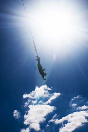 Bungee jumping - extreme sport over blue sky