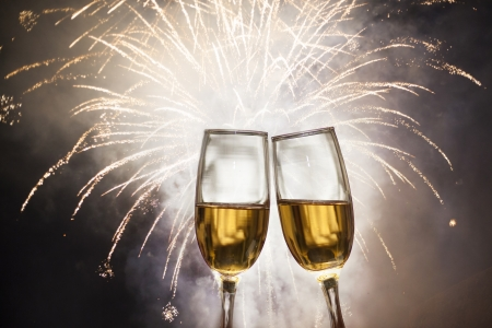 Glasses with champagne against fireworks Stock Photo
