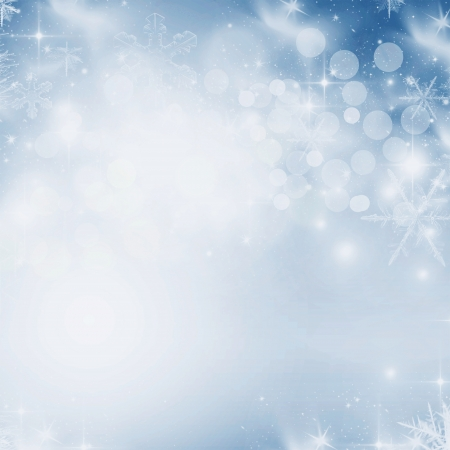 Light abstract Christmas background with white snowflakes photo