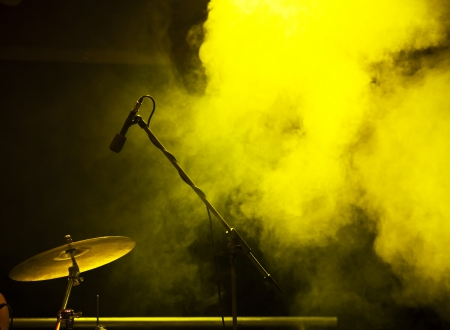 smoke effect: Microphone in stage lights during concert