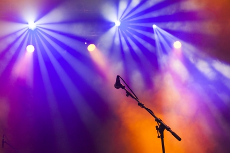 music production: Microphone in stage lights during concert