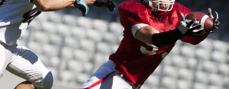 american football game with out of focus players  Foto de archivo