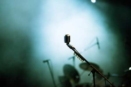music production: Microphone in stage lights