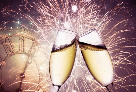 past midnight: background with champagne glasses and clock