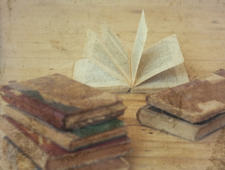 Old books on wooden background photo