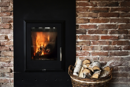 Fireplace with burning fire photo