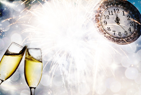 new year eve beads: Champagne glasses, clock and fireworks at midnight Stock Photo