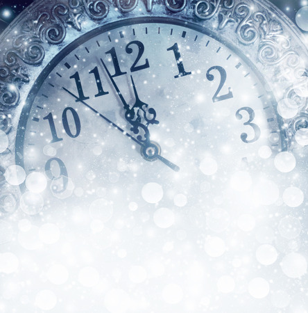 New Year's at midnight - old vintage clock and holiday lights Stock Photo - 24678298