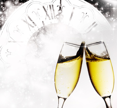 new year eve beads: Glasses with champagne against holiday lights Stock Photo