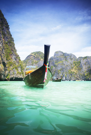 Thailand beach on tropical island. Beautiful travel background of Asia coast  photo
