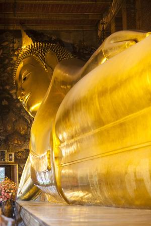 Reclining Buddha gold statue  Wat Pho, Bangkok, Thailand photo