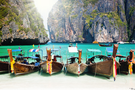 longtail: Thailand ocean landscape. Exotic beach view and traditional ship in Maya Bay, Ko Phi Phi Don