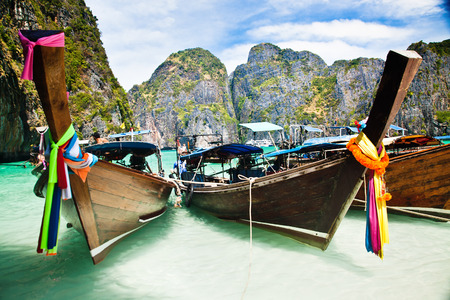 Thailand ocean landscape. Exotic beach view and traditional ship in Maya Bay, Ko Phi Phi Don photo