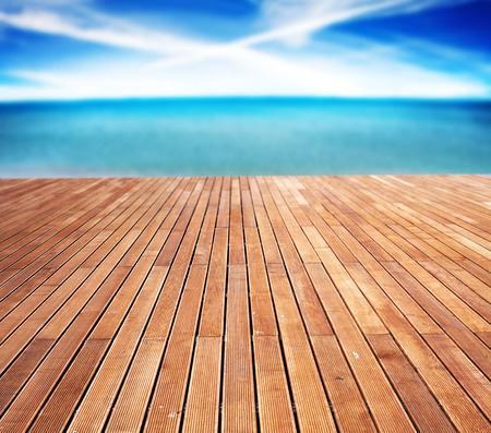 Sunny sea and wooden walkway photo